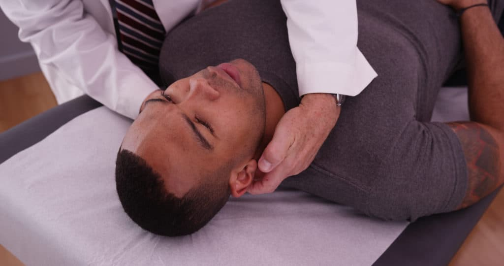 African-american,Male,Patient,Having,Neck,Pain,Examined,By,Chiropractor.
